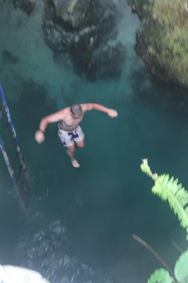 jamaica jumping into a mineral spring